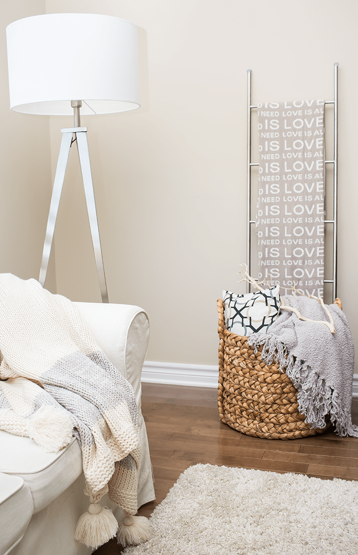 Pillows and blankets in a basket adds instant appeal (and functionality) to a space.