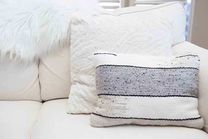 Pillows and blankets can make any space in your home look better, instantly.