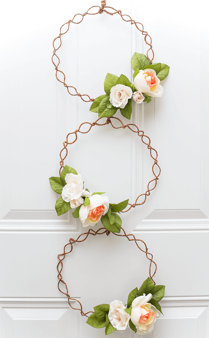 Make this simple door wreath using flowers and grapevine wire.