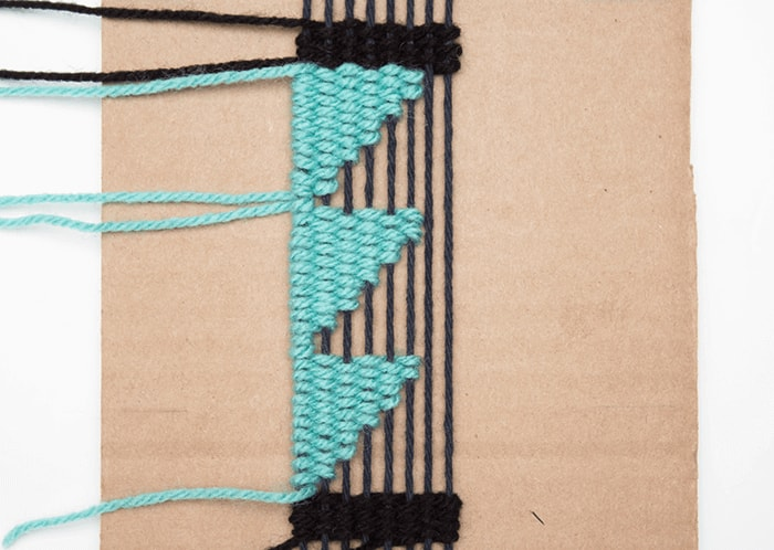 Complete the third angle in your woven bookmark.