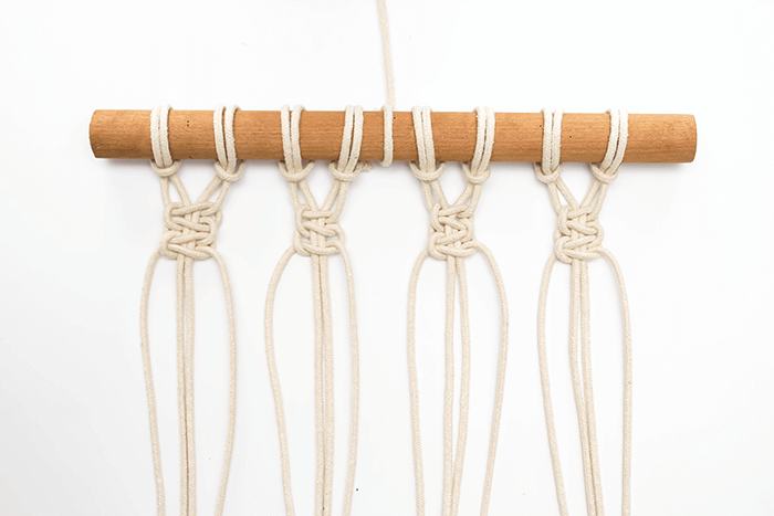 DIY mini macrame wall hanging: first row of square knot pairs.