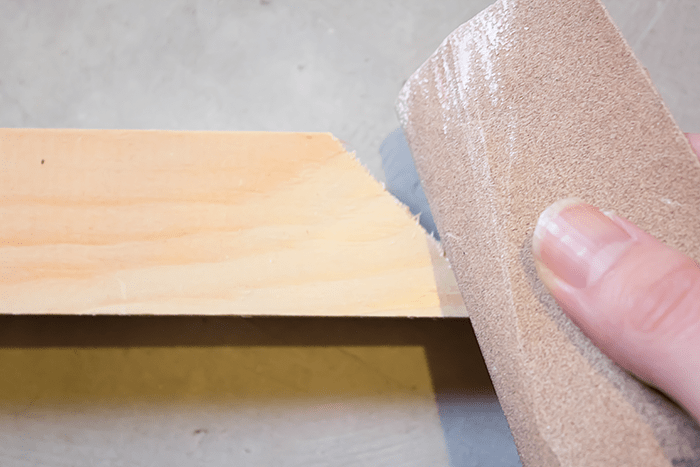 How To Make a Frame for Canvas Art - sandpaper edges