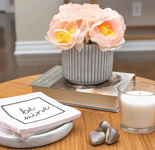 Florals, napkins, a candle and chocolates | Valentine Vignette