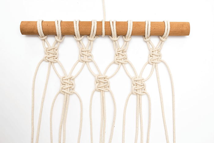 DIY Mini Macrame Wall Hanging: second row of paired square knots.