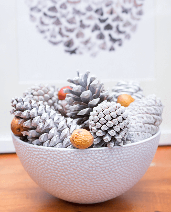 Celebrate fall with white pinecone decor.
