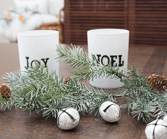 Greenery and holiday accessories make for a sweet holiday vignette.