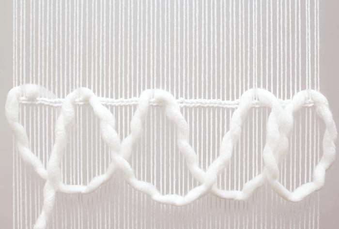 Easy wavy woven fringe detail.