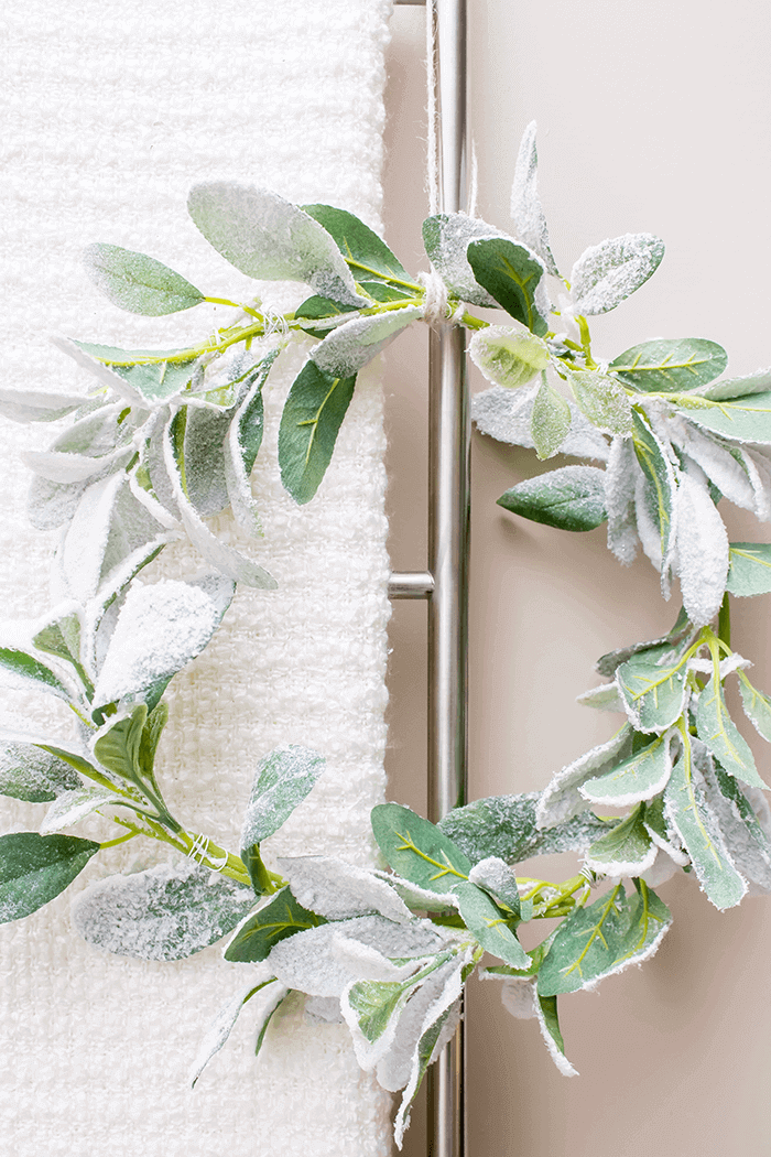 Simple DIY wreath completes this storage ladder vignette.