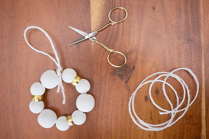 DIY Wood Bead Christmas Ornaments - add twine.
