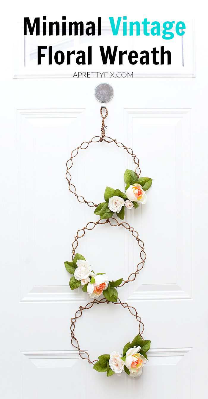 Create something utterly unique for your front door decor with this long and delicate minimal vintage floral wreath. It is the perfect twist on a traditional craft that you will love to hang! (Easily comes apart to hang as single wreaths, too!) | APRETTYFIX.COM