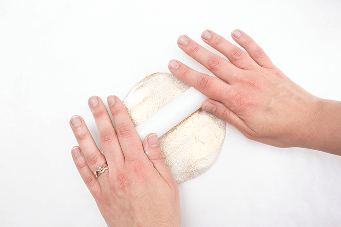 Roll out clay using a rolling pin.