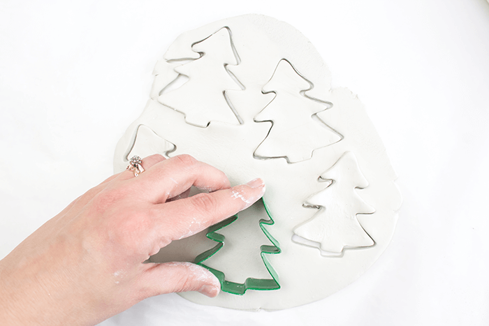 Create Christmas tree designs using cookie cutters.