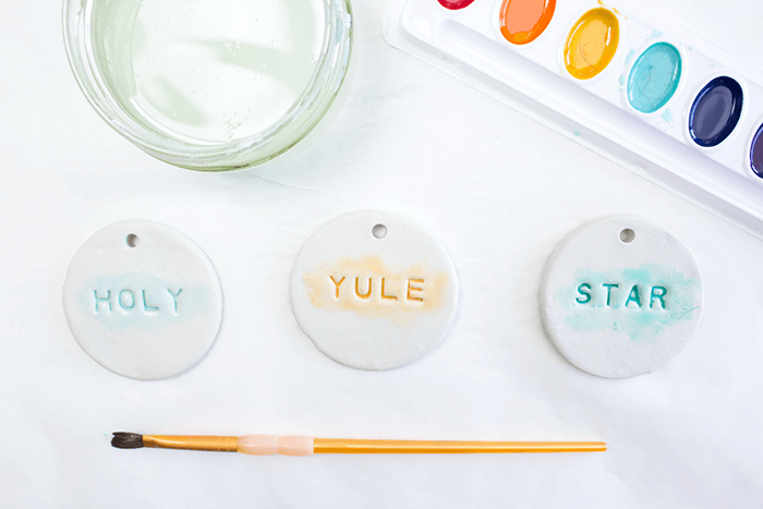 Add watercolours to each air dry clay ornament.