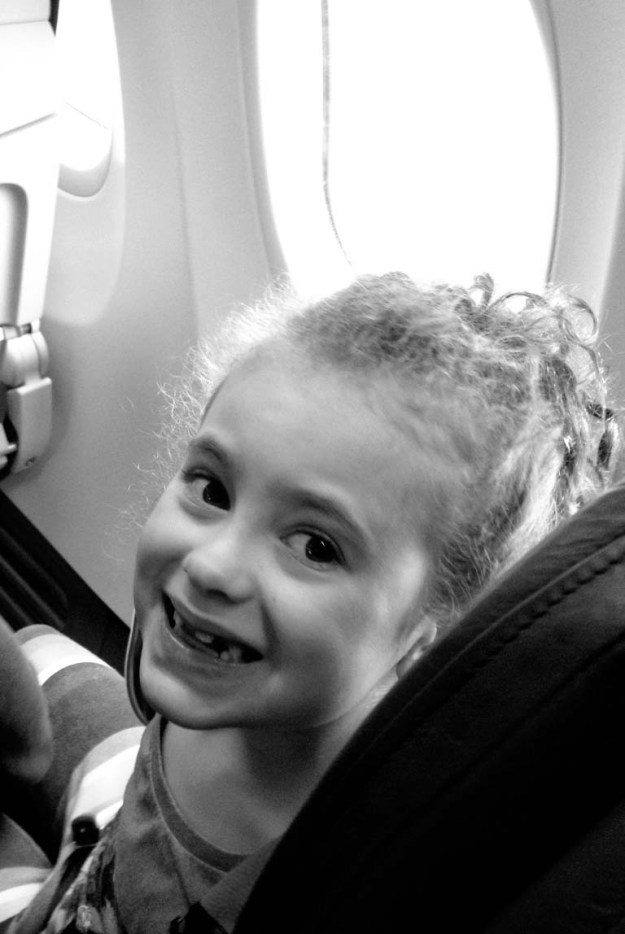 Happy on an airplane.