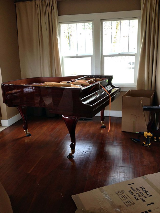 Piano preparing to be moved.