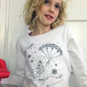 "Beautifully handprinted, high-quality 100% cotton long sleeve t-shirt. Magical parachuting snowflake fairy drawn especially for this t-shirt by April's sweet sister Janet. Coloring in the t-shirt design with fabric markers or sharpies makes it extra fun - a ""custom design"" each child can make for their very own."