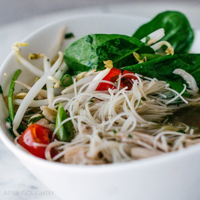 Instant Pot Pho Chicken Soup Recipe made in only 35 minutes with Pho spices, lime, cilantro, tomatoes, hoisin, bean sprouts, and more yummy ingredients