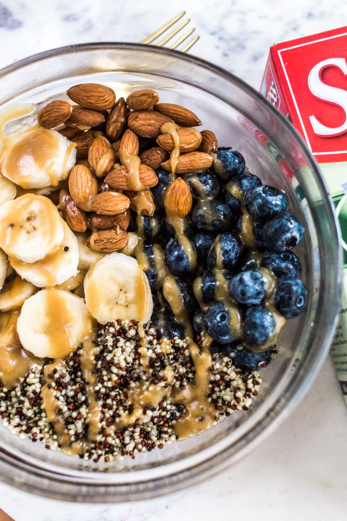 Quinoa Almond Fruit Bowl Recipe that is made with Success Tri-Color 100% Quinoa boil in a bag with sliced banana, blueberries, almonds, almond butter and agave perfect for breakfast.