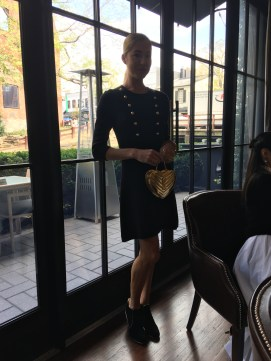 Burberry military inspired knit dress paired with a gold YSL bag