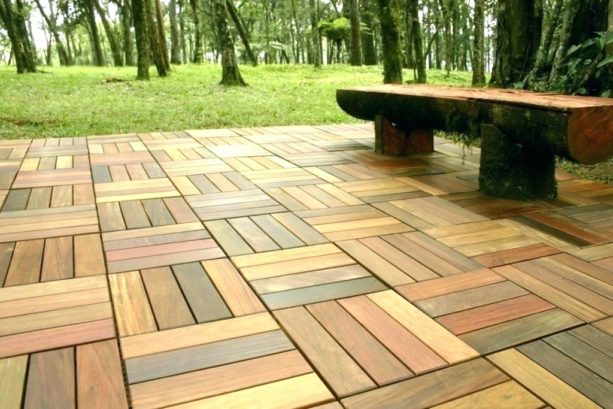 interlocking patio tiles over grass 7