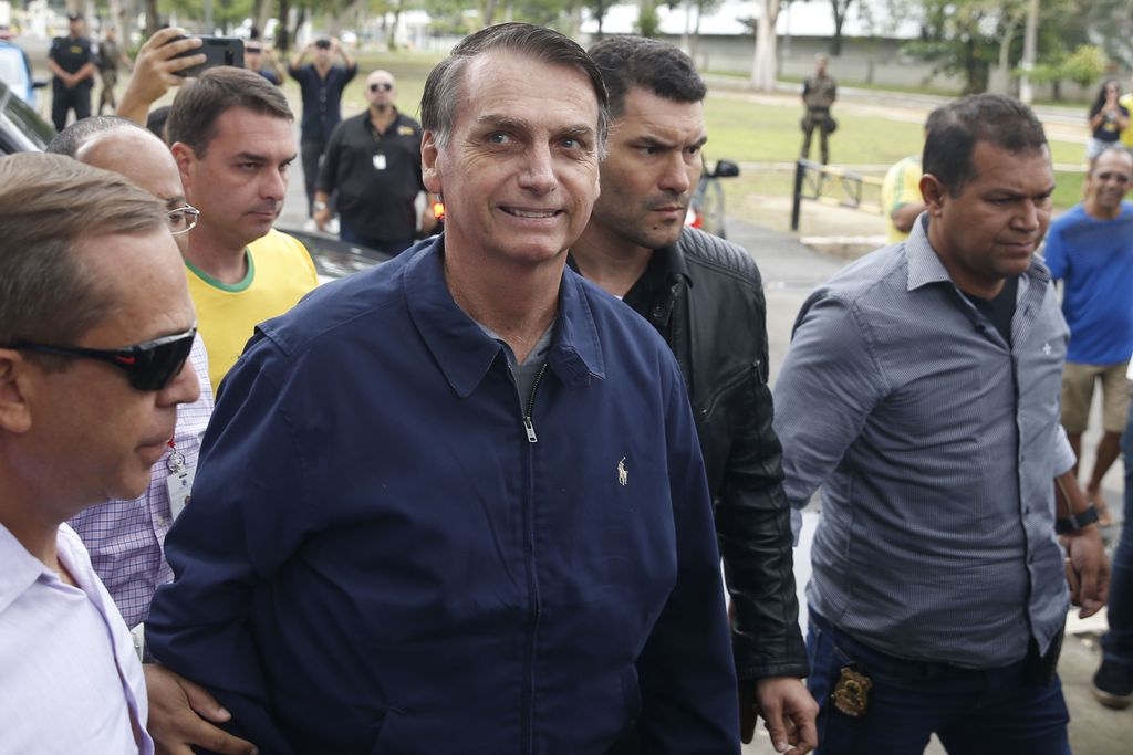 O candidato à Presidência Jair Bolsonaro (PSL) chegando a seção eleitoral em 7 de outubro de 2018