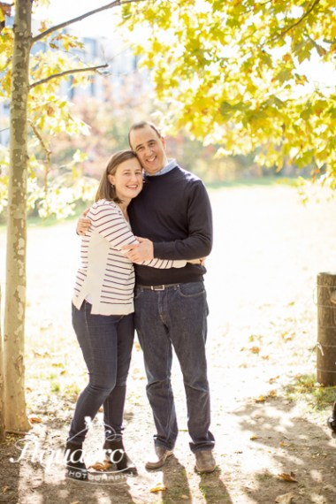 mom and dad pose in brooklyn in autumn light