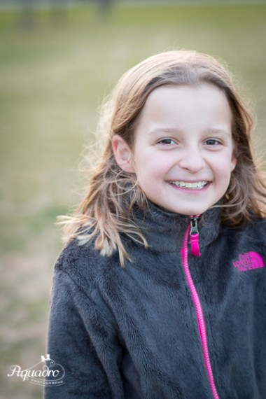 girl in north face fleece smiles in brooklyn park