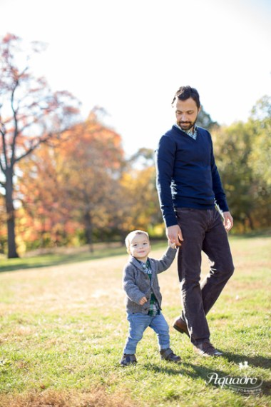 Dad and 2 year old son walk in Prospect Park, Brooklyn