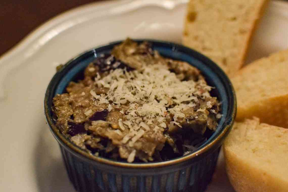 eggplant puree in a bowl with sliced bread