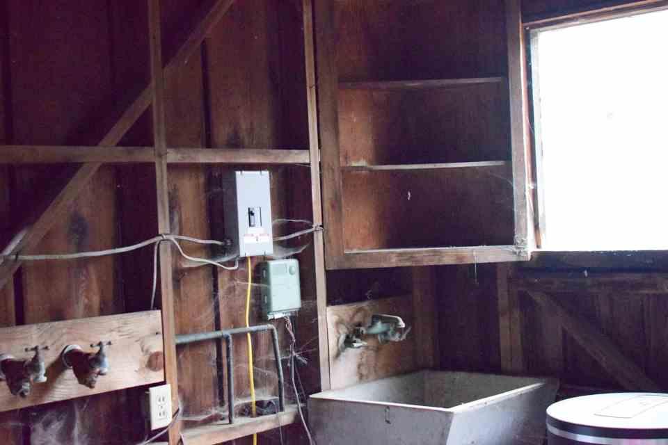 a sink, cobwebbs inside an old garden shed project
