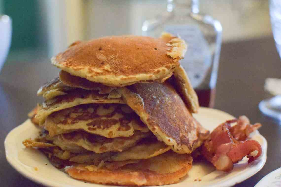 A large stack of pancakes on a plate