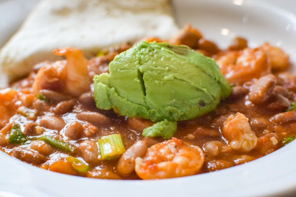 shrimp and pinto beans upclose in a bowl