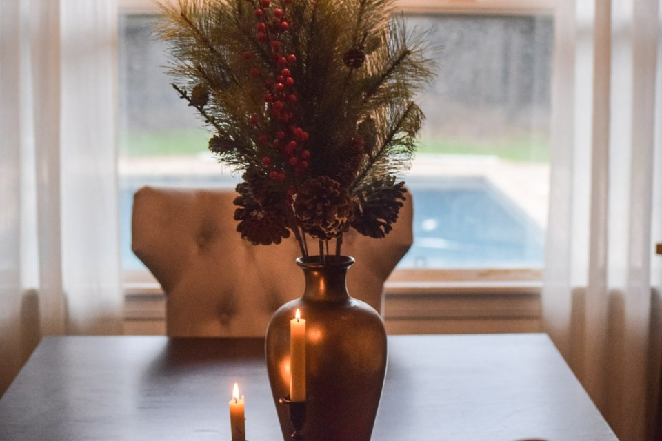 preppering for fall with a vase with pine cones