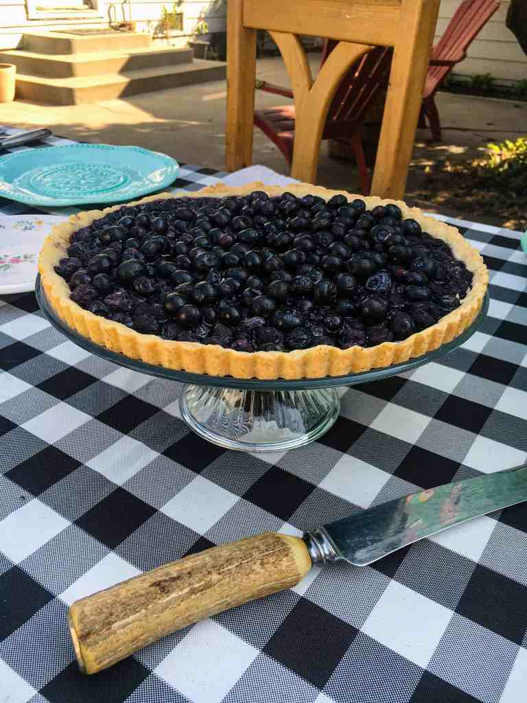 buffalo checkered table cloth and a blueberry pie