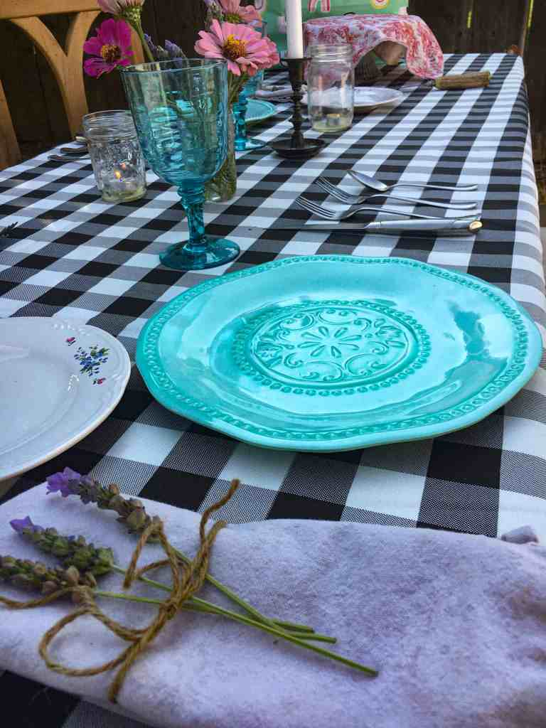 practicing hospitality checkered table cloth wiith plates and glasses