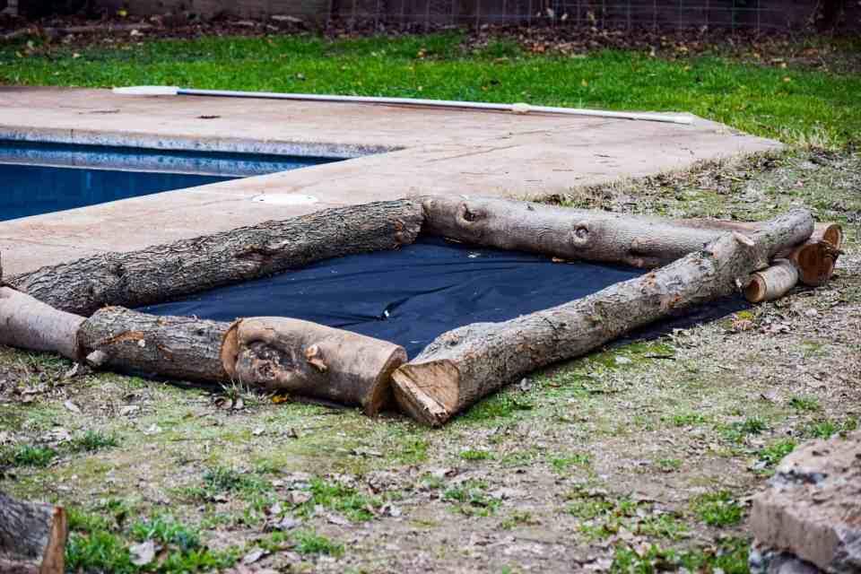 log garden bed in urban farmhouse