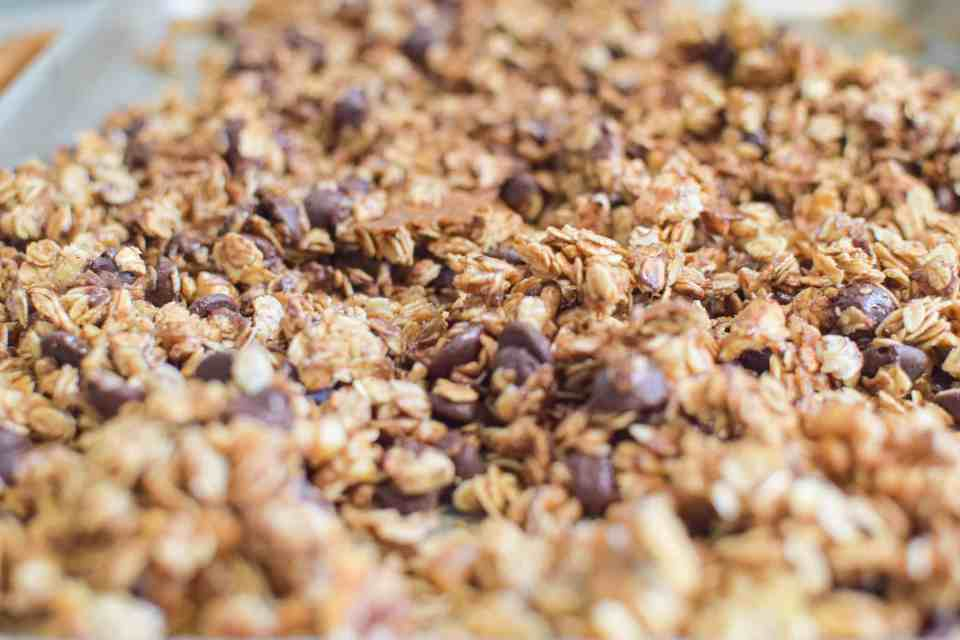 chocolate and walnut granola on a cookie sheet