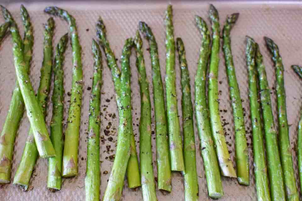 roasted asparagus on a baking sheet