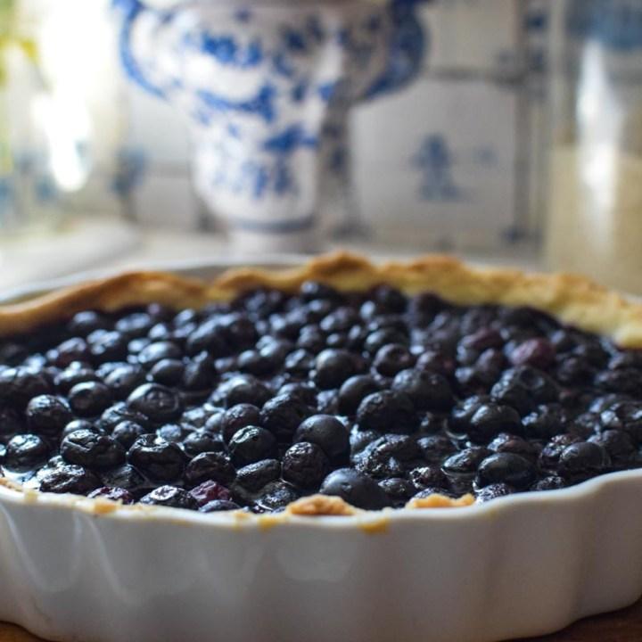 blueberry tart on a cutting board