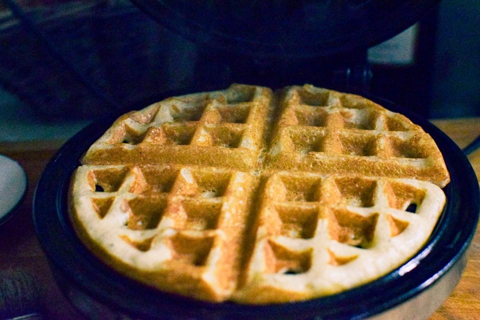sourdough waffle in a waffle iron