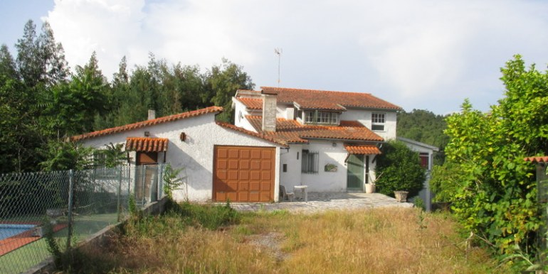 main house with swimming pool to the left
