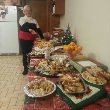 Christmas Eve is one of the most significant days throughout the holidays in the Italian culture. Here's my grandmother showing off our cookies.