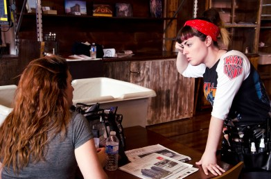 Hair and make up stylist Emily O'Quinn and her assistant Ashley Vieira talking between takes on set.
