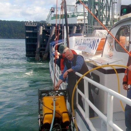 Mystic Sea Crew lowering ROV to inspect Lopez ferry dock for Washington State Ferries Department of Transportation (Photo Credit: Leizel Yaeger)