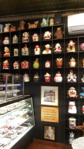 Various antique cookie jars sit in cubbies along one wall of the Cookie Jar