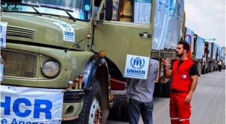 قافلة مساعدات تدخل الرستن وسط سوريا