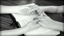 parent-childholding-hands-bible