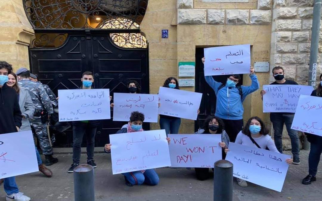 اشكال وتدافع بين المتظاهرين أمام الاميركية والقوى الامنية بعد محاولة اقتحام الجامعة