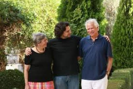 With her son, the poet and political scientist Tamim Barghouti and husband Mourid.