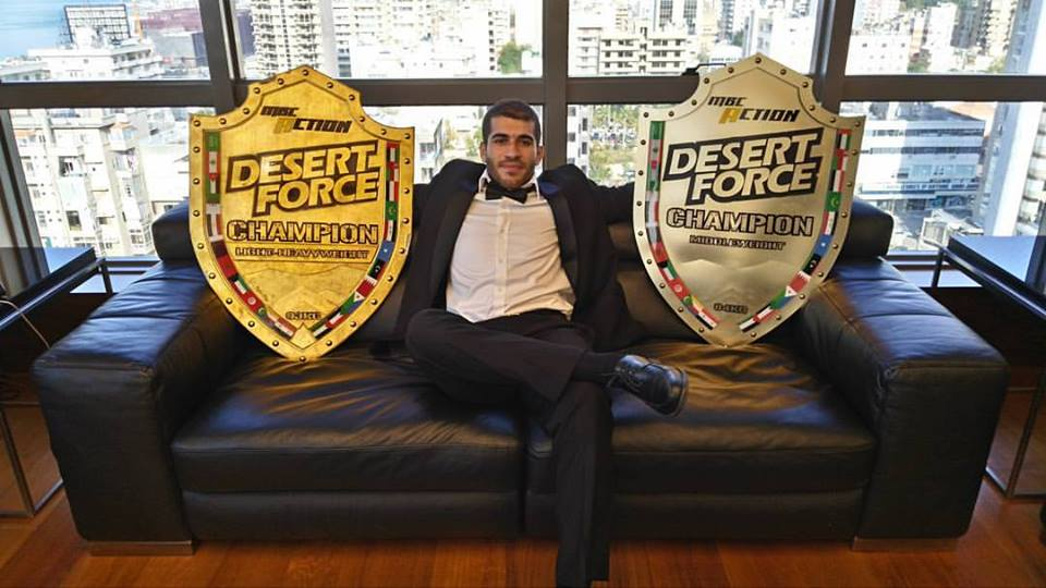 Mohammad Karaki Holding the Desert Force Light Heavyweight and Middleweight Shields